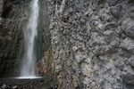 Waterfall and volcanic rock in Arusha National park, Tanzania