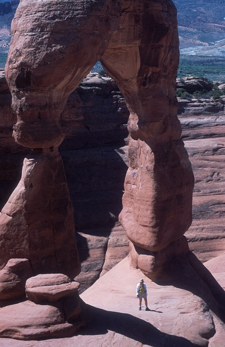 Hiker in Delicate arch